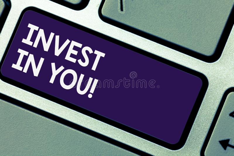 Writing note showingInvest In You. Business photo showcasing Take care of yourself buy things for you Motivation Inspire Keyboard. Key Intention to create stock photography