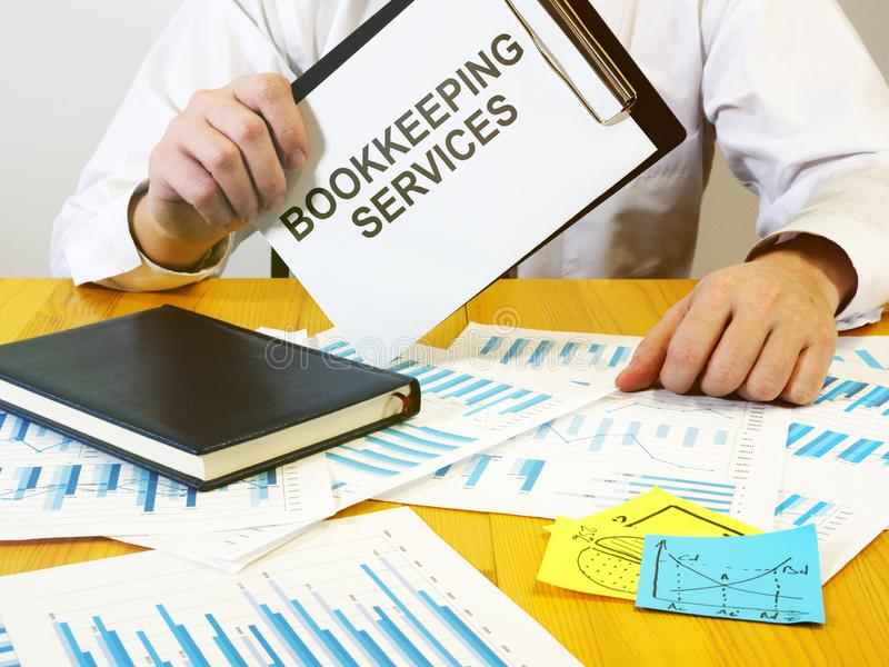 Writing note shows the text bookkeeping services. Writing note shows the text a bookkeeping services royalty free stock photo