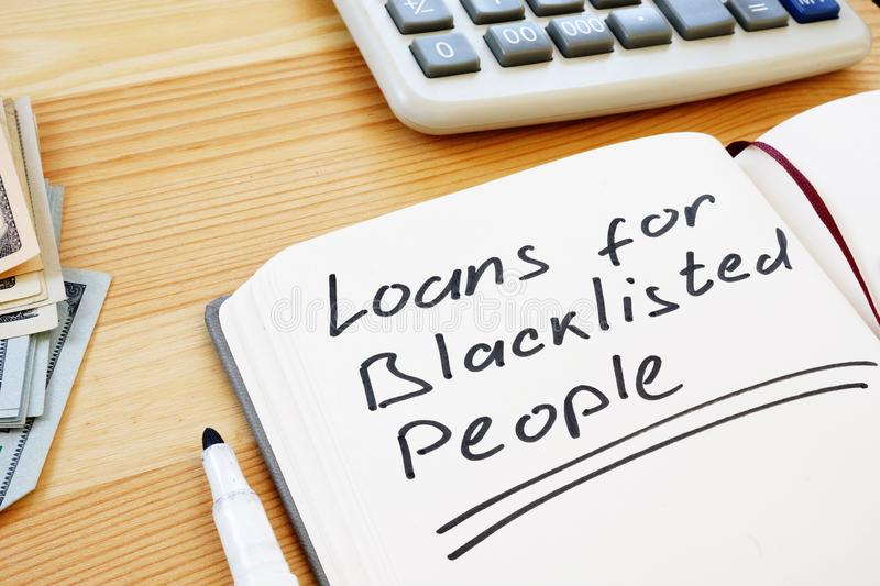 Writing note shows the text loans for blacklisted people stock photos