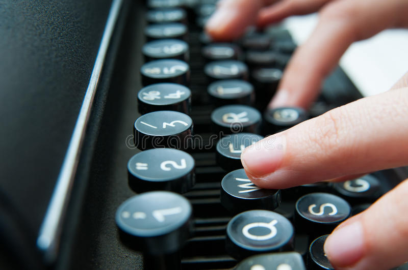 Writing on an old keyboard. Old school writing on a vintage typewriter in close up mode as a communication concept stock photo