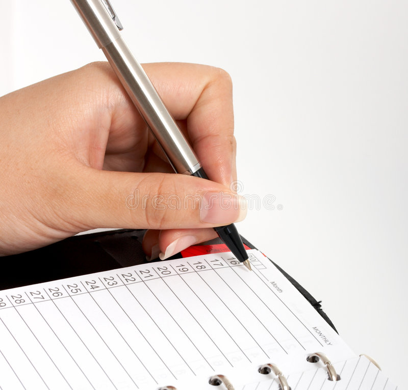 Download Writing on an organizer stock photo. Image of notebook - 3557876