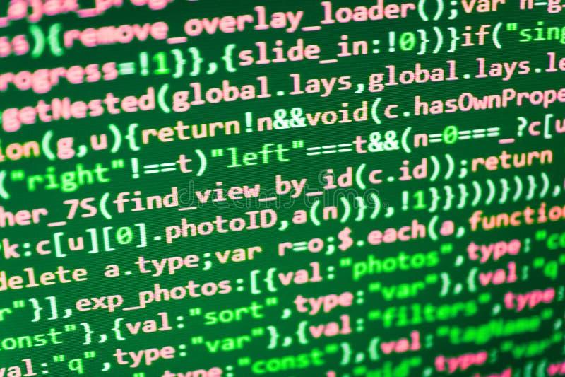 Writing programming code on laptop. Software engineer at work. Writing programming code on laptop royalty free stock image