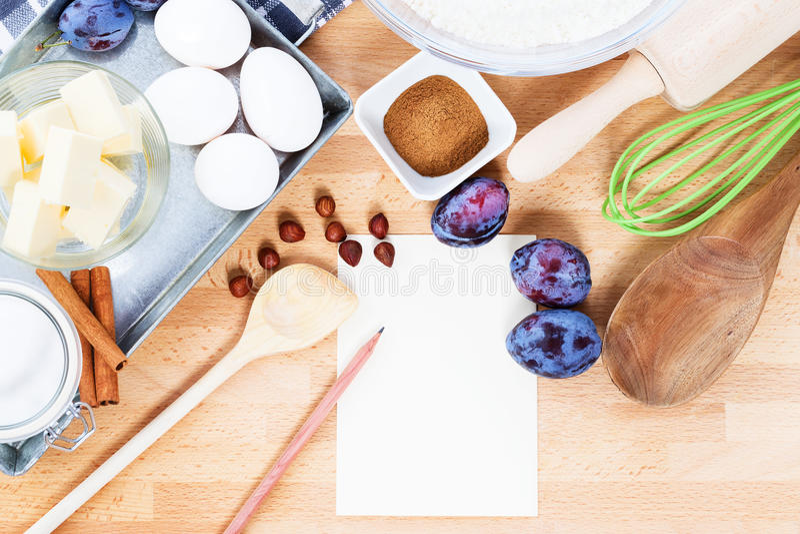 Writing a recipe for plum cake royalty free stock photos