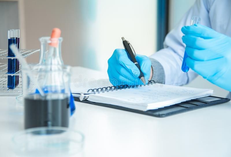 Writing Reporting of Medical or science medical in laboratory room research performs tests with liquid, Experimental Drug royalty free stock image