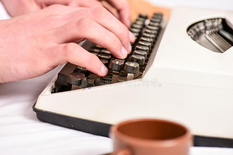 Writing routine. Vintage typewriter concept. Hands typing retro writing machine. Old typewriter and authors hands. Male. Hands type story or report using white stock image