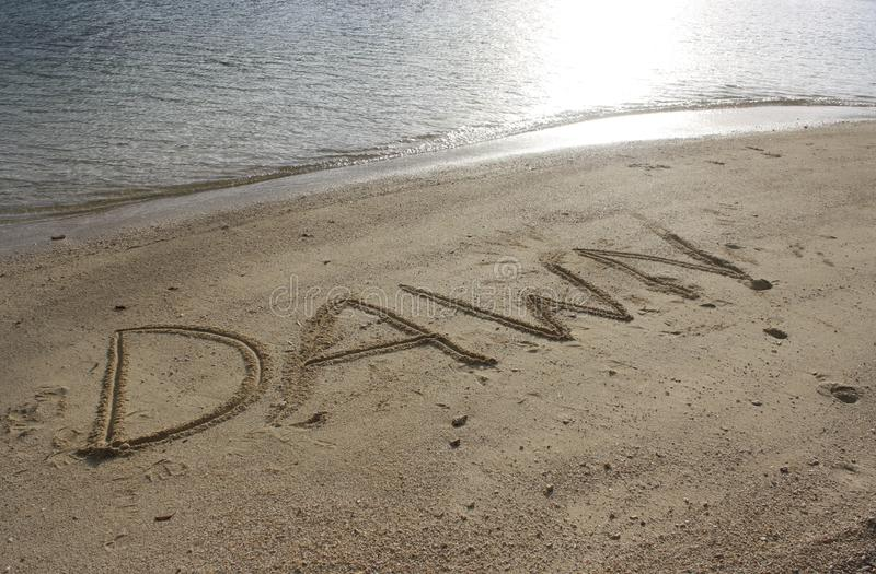 Writing in the sand royalty free stock photography