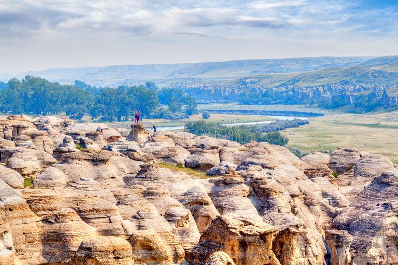 Writing-on-Stone Provincial Park in Alberta, Canada. LETHBRIDGE, CANADA - AUG 22, 2016: Visitors pose for pictures on top of the hoodoos at Writing-on-Stone stock photo