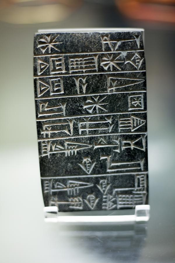 Writing on the stone wall of the ancient Black steatite tablet, incised cuneiform inscription polished surfaces. Ruler: Shulgi, Th stock photo