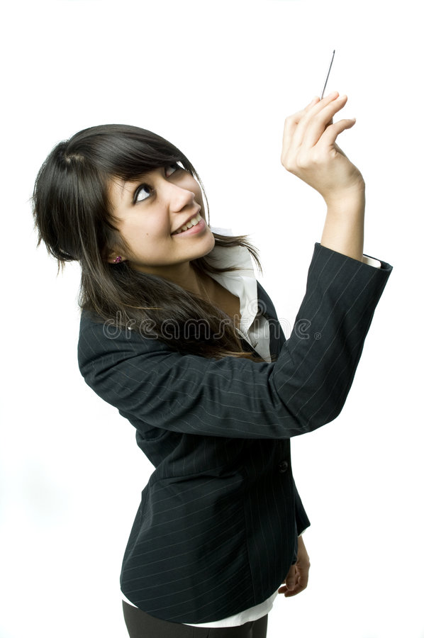 Writing with a stylus. A young business woman writing on backdrop with a stylus pen stock images