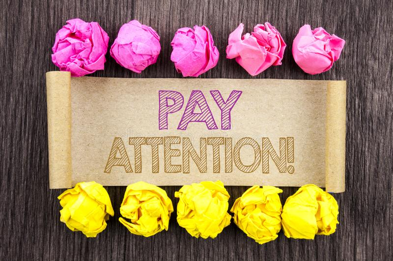 Writing text Pay Attention. Concept meaning Be Careful Beware Mindful Alarm written on sticky note paper with folded paper yellow. Writing text Pay Attention royalty free stock photo