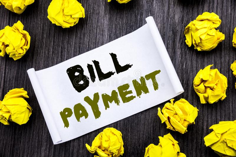 Writing text showing Bill Payment. Business concept for Billing Pay Costs Written on sticky note notepad note notebook book wooden. Writing text showing Bill royalty free stock photo
