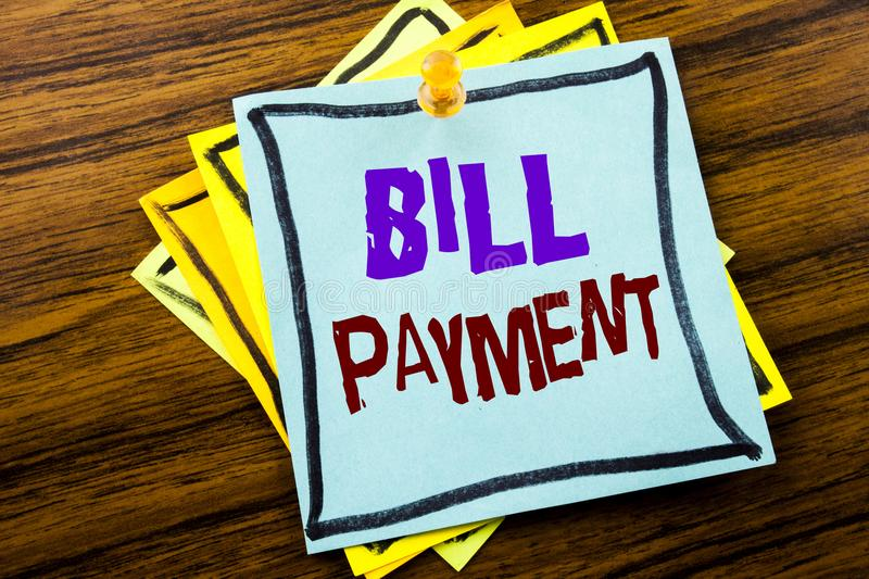 Writing text showing Bill Payment. Business concept for Billing Pay Costs written on sticky note paper on the wooden background. Writing text showing Bill stock photography