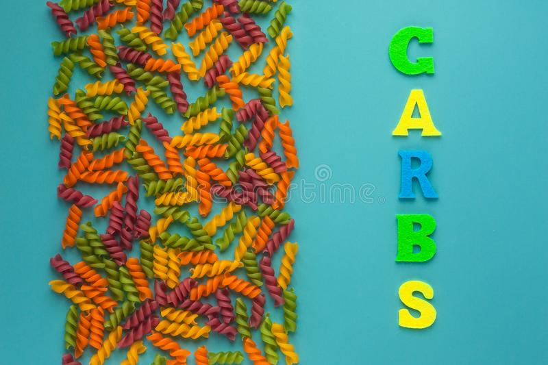 Writing text showing carb of multicolored letters. Colorful background. Abstract set on colorful backdrop with colored pasta. Writing text showing carb of royalty free stock image