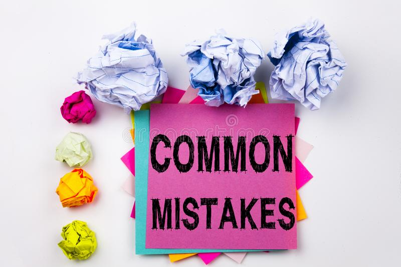 Writing text showing Common Mistakes written on sticky note in office with paper balls. Business concept for Common Decision. Mistakes on the isolated royalty free stock photos