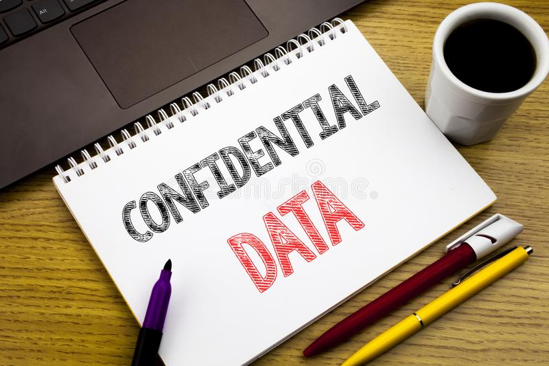 Writing text showing Confidential Data. Business concept for Secret Protection written on notebook book on the wooden background i. Writing text showing royalty free stock photo