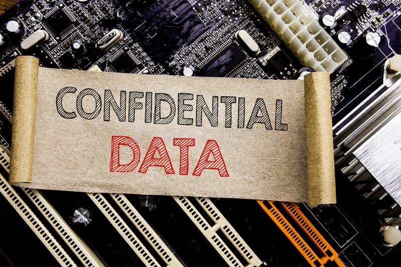 Writing text showing Confidential Data. Business concept for Secret Protection Written on sticky note, computer main board backgro. Writing text showing stock photos