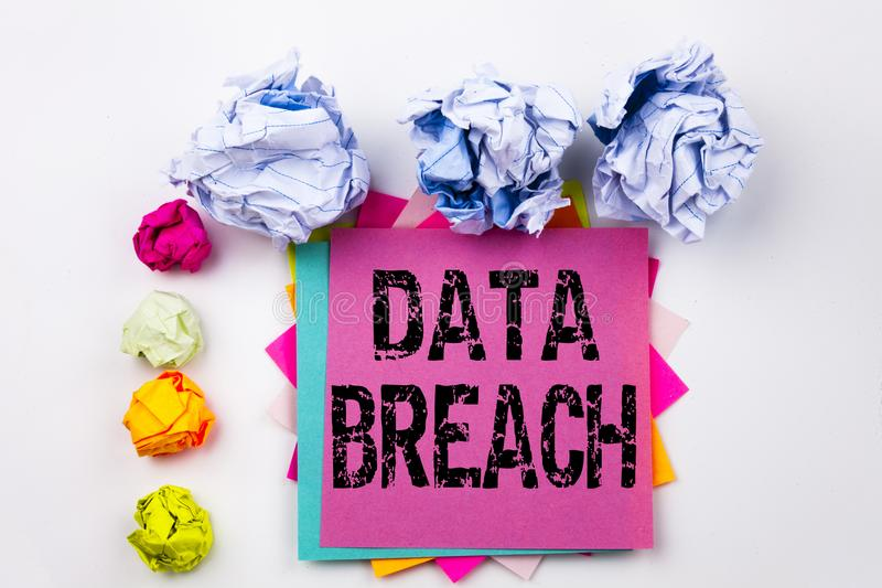 Writing text showing Data Breach written on sticky note in office with paper balls. Business concept for Tech Internet Netwo. Rk Breaking into Database on white royalty free stock image