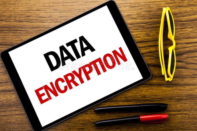 Writing text showing Data Encryption. Business concept for Information Security Written on tablet laptop, wooden background with v. Writing text showing Data royalty free stock image