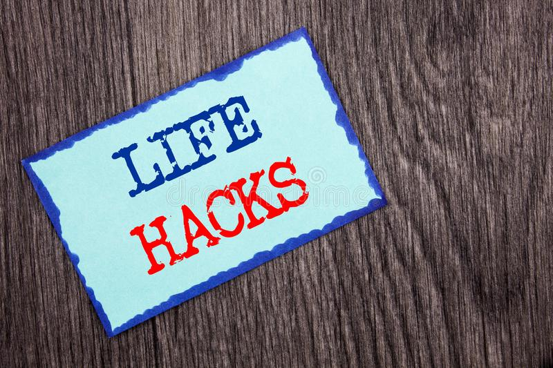 Writing text showing Life Hacks. Business photo showcasing Solution Hacking Hack Trick To Help Efficiency written on Blue Sticky royalty free stock image