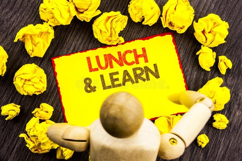 Writing text showing Lunch And Learn. Business photo showcasing Presentation Training Board Course written on Sticky Note Holding. Writing text showing Lunch And royalty free stock images