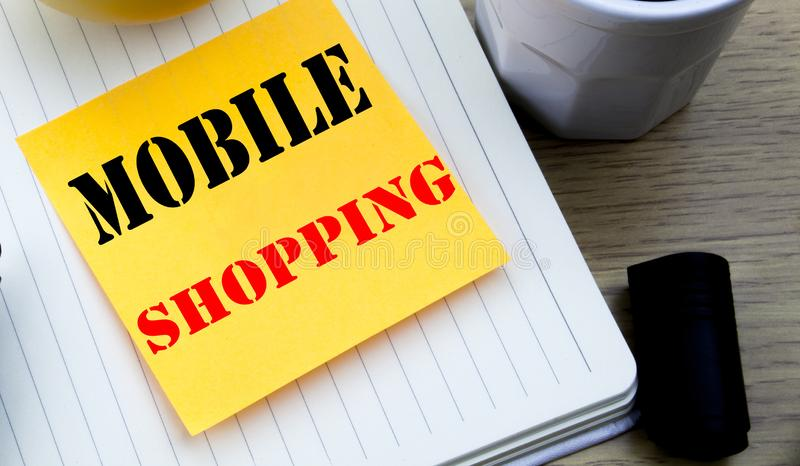 Writing text showing Mobile Shopping. Business concept for Cellphone online order written sticky note empty paper, Wooden backgrou. Writing text showing Mobile royalty free stock images