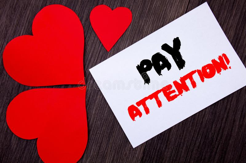 Writing text showing Pay Attention. Concept meaning Be Careful Beware Mindful Alarm written on notobook paper note on the wooden. Writing text showing Pay royalty free stock photography