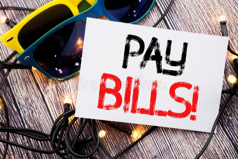 Writing text showing Pay Bills. Business concept for Finance Paying Online written on sticky note with copy space on old wood wood. Writing text showing Pay royalty free stock images