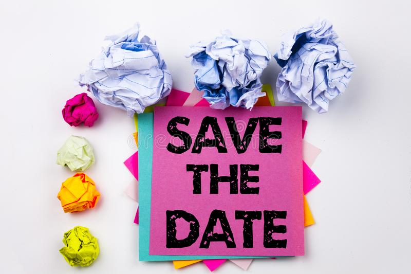 Writing text showing Save The Date written on sticky note in office with paper balls. Business concept for Special Day and G stock images