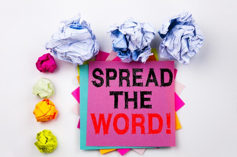 Writing text showing Spread The Word written on sticky note in office with paper balls. Business concept for Announcement Bu royalty free stock photography