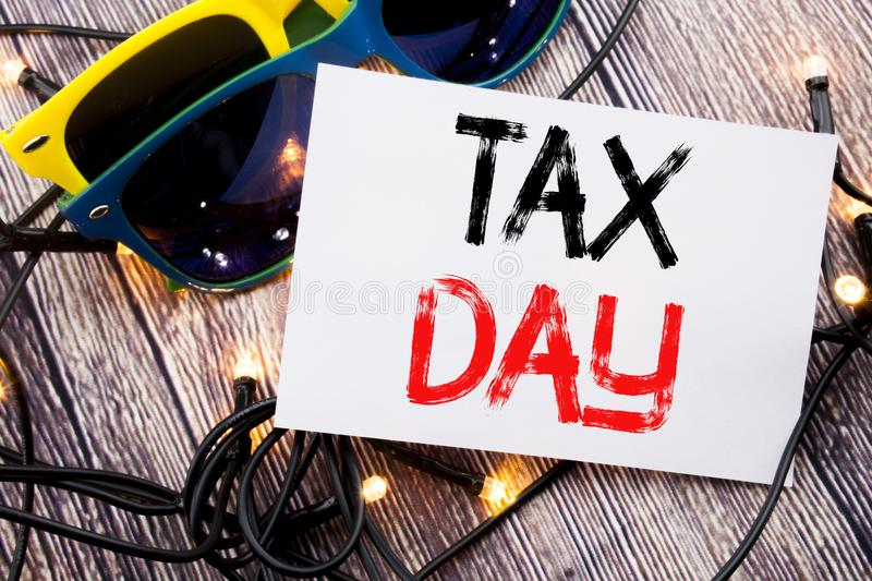 Writing text showing Tax Day. Business concept for Income taxation Refund written on sticky note with copy space on old wood woode stock images