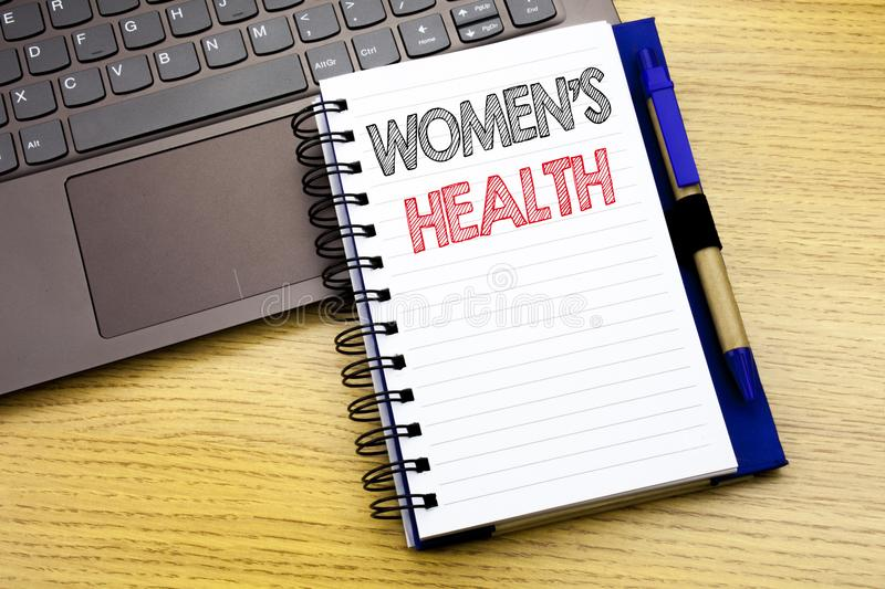 Writing text showing Women s Health. Business concept for Female Celebration written on notebook book on the wooden background in. Writing text showing Women & stock photos