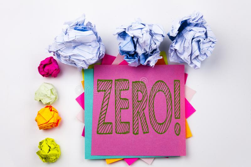 Writing text showing Zero written on sticky note in office with paper balls. Business concept for Zero Zeros Nought Toleranc. E on white isolated background royalty free stock images