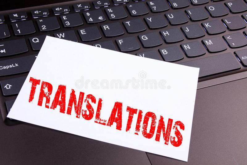 Writing Translations text made in the office close-up on laptop computer keyboard. Business concept for Translate Explain Plead B. Ook Language Workshop on the stock images