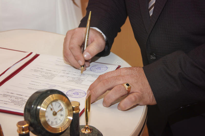 Writing wedding vow. Groom writes his wedding vow royalty free stock images