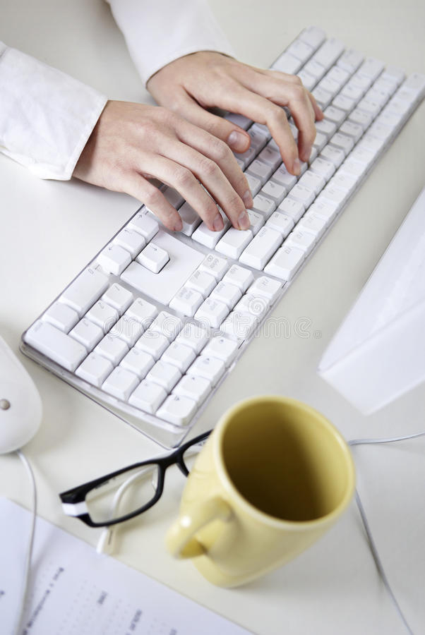 Writing on a white computer keyboard stock photography