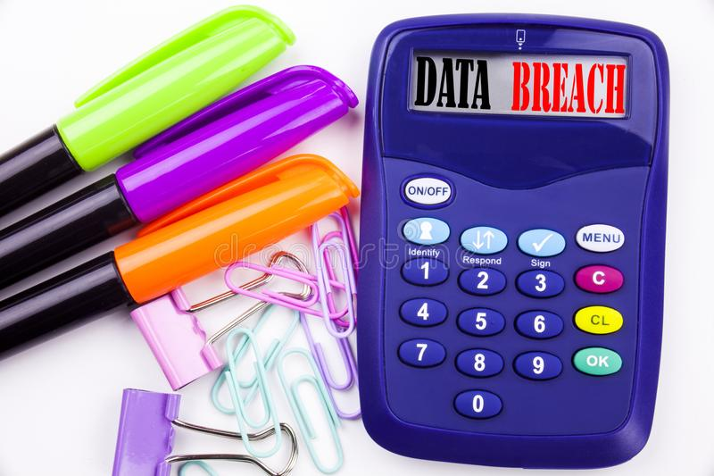 Writing word Data Breach text in the office with surroundings such as marker, pen writing on calculator Business concept for Tech. Internet Network Breaking stock photo