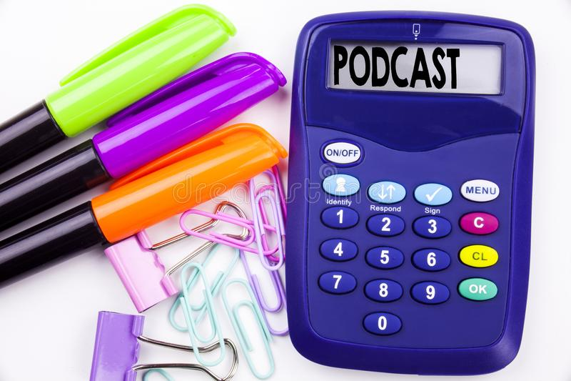 Writing word Podcast text in the office with surroundings such as marker, pen writing on calculator. Business concept for Internet. Broadcasting Concept white stock photo
