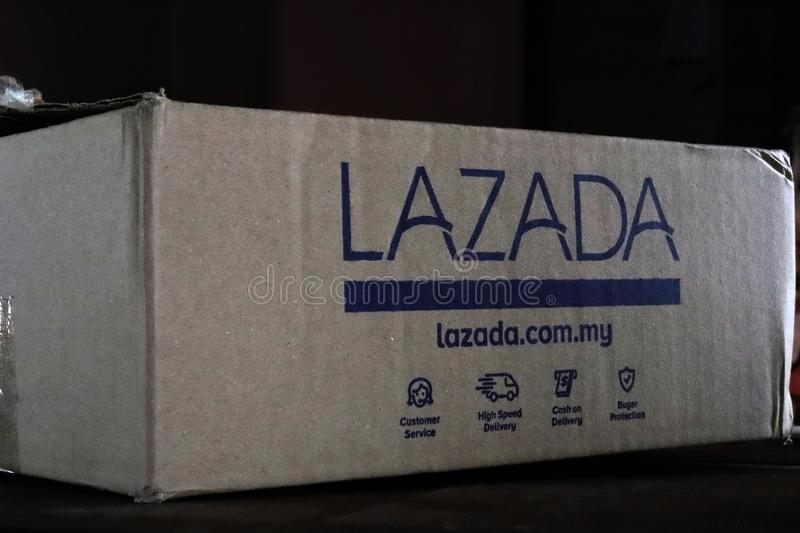 Writings On A Lazada Shipping Cardboard Box. Website URL and services offered by Lazada Malaysia written on its shipping cardboard box. Lazada is a leading stock photography