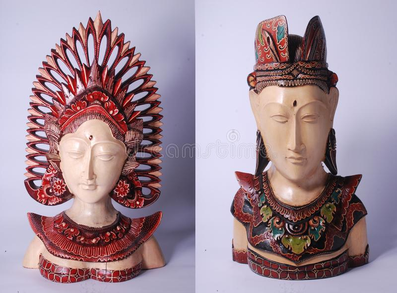 Written batik in bride statues using traditional Balinese clothes stock images