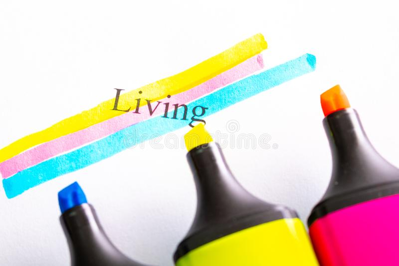 Written life and circled with different colored markers, yellow red blue. Markers out of focus in the foreground stock photo