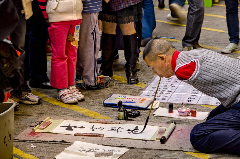 Written by Mouth. This photo is taken at Mong Kok in Hong Kong during the Chinese New Year. It has the contrast between the happiness and upset. The disabled stock photos
