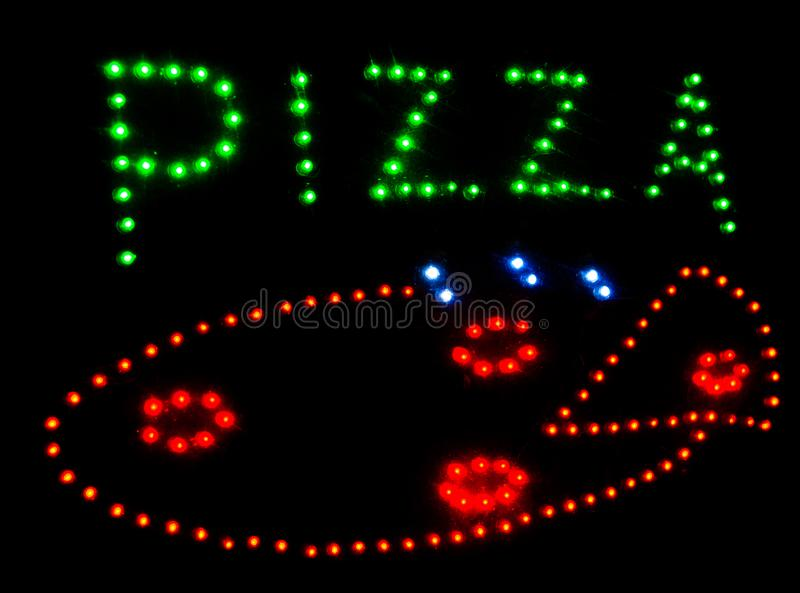 Written Pizza with leds and black background. Colorful written and draw of Pizza outside restaurant stock photography