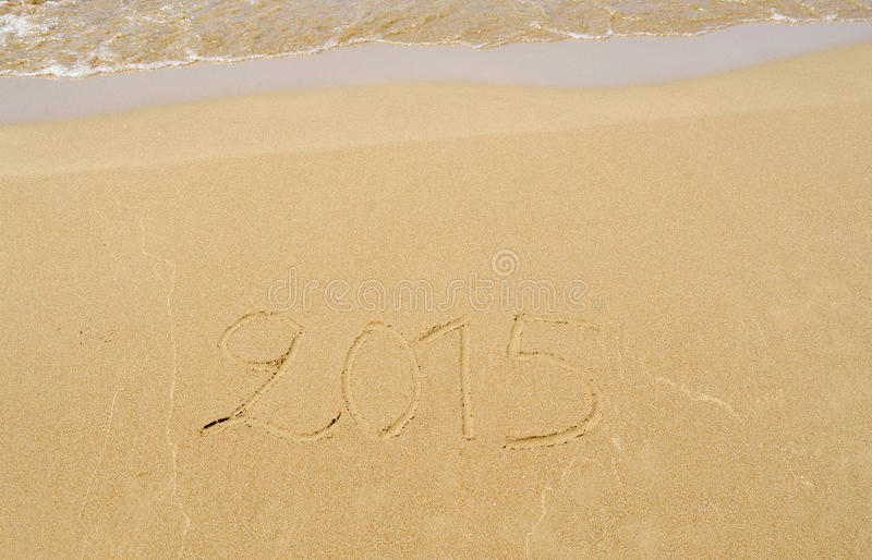 2015 written in the sand stock image