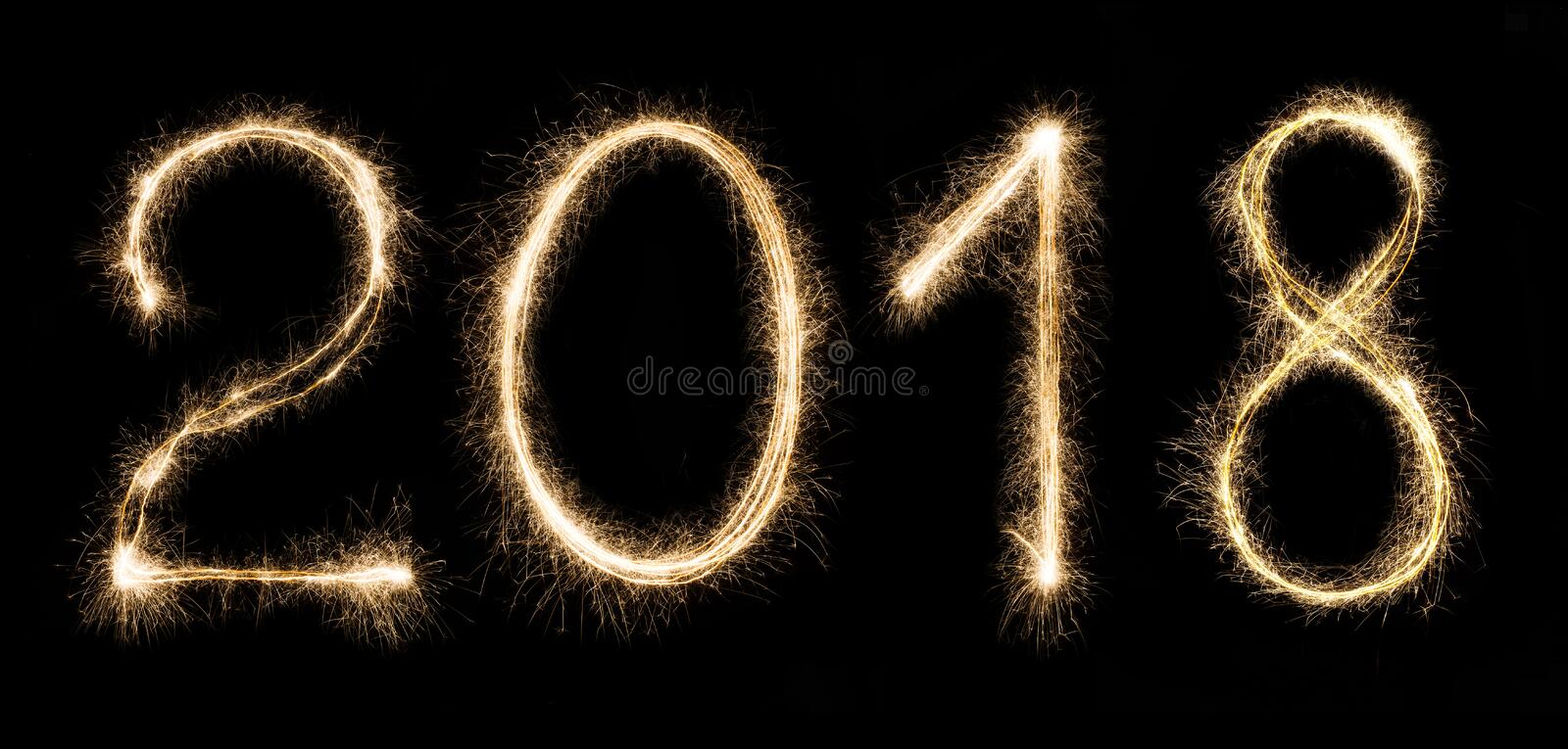2018 written with a sparklers isolated on black background stock photo