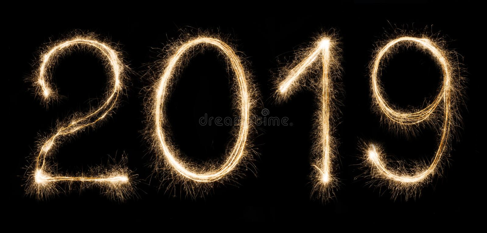 2019 written with a sparklers isolated on black background royalty free stock photography
