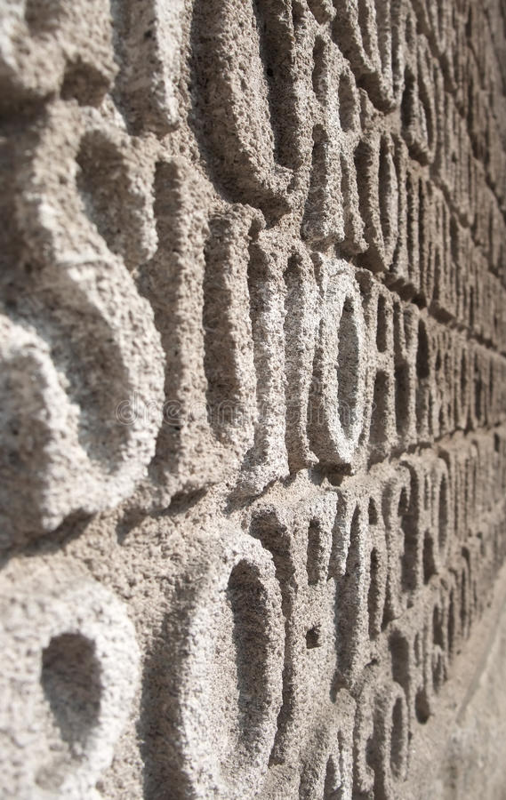 Written in Stone. Words Written in Stone: Abstracted Religious Text on Church Wall stock images