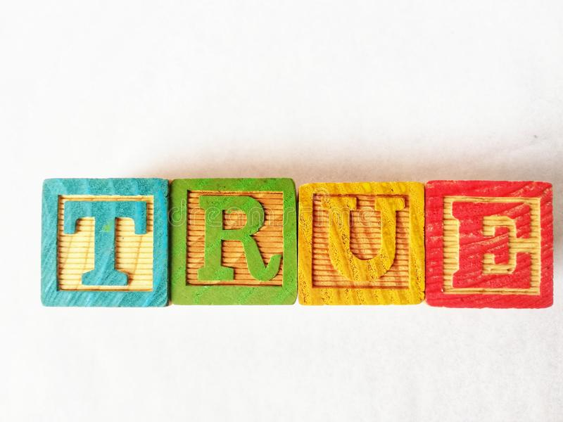 Written :True with wooden cubes. Written :True with cubes royalty free stock images