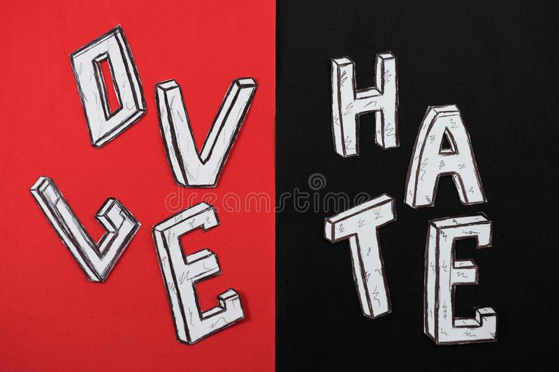 Written word love on a red background and hate on a black background.  royalty free stock photo