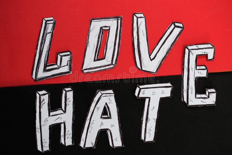 Written word love on a red background and hate on a black background.  royalty free stock image