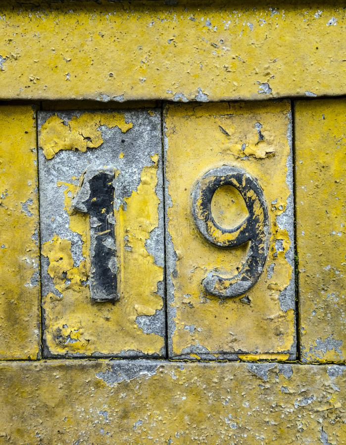 Written Wording in Distressed State Typography Found Number 19 nineteen. Written Wording in Distressed State Typography Found Number on a sign royalty free stock images
